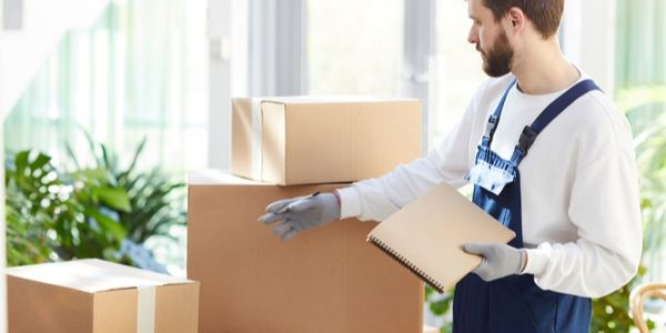 movers preparing list of items