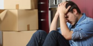 man in stress while moving house